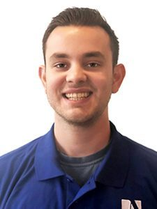 Jack, our Systems Engineer, is directly facing the camera with a bright smile and wearing a blue ArcSource polo shirt.